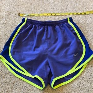 Purple, blue, and neon free Nike shorts